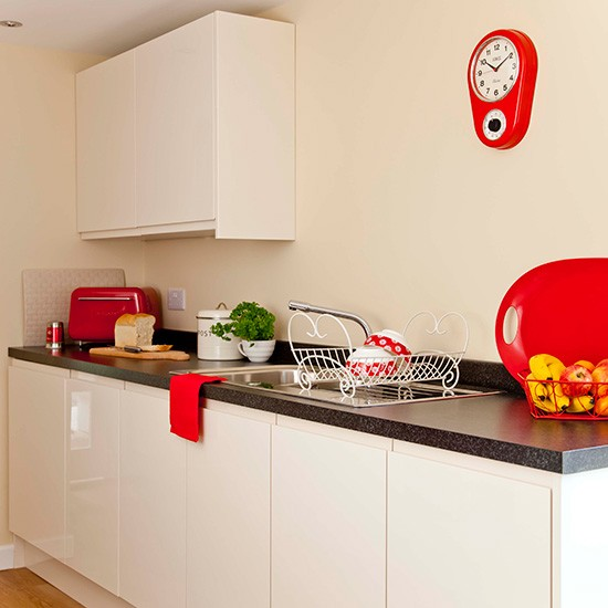 Small white kitchen with funky red accents - White kitchen red accents ...