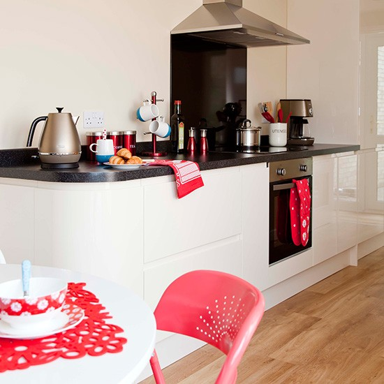Contemporary Red Kitchen: White Modern Kitchen-diner With Red Accessories