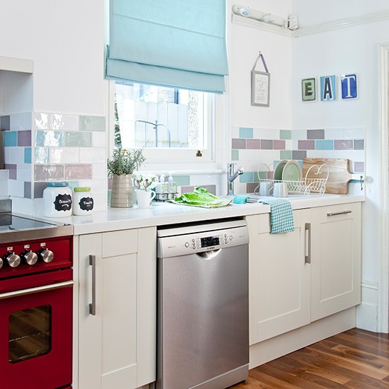 White Kitchen With Pastel Tiles And Pale Blue Blind