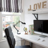Modern monochrome home office with striped blind