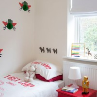 Boy's red and white bedroom with bees