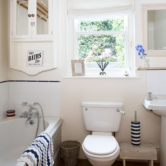 nautical bathroom with country style cabinets and striped bahtroom soothing nautical bathroom decor ideas making