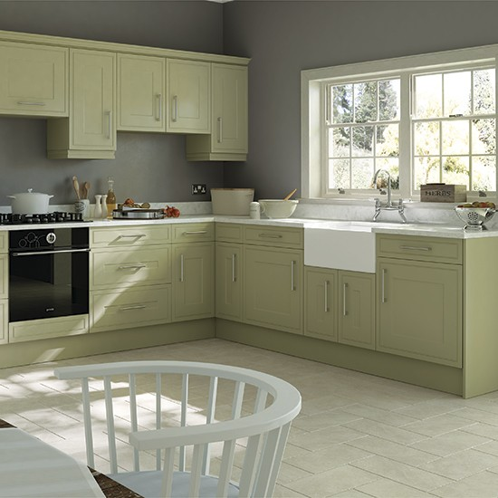 Traditional style kitchen with olive cabinetry green for Coloured kitchen units uk