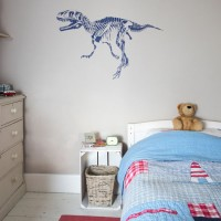 Child's room with seaside bed linen and dinosaur