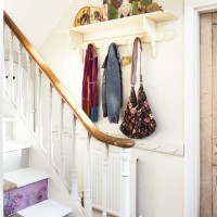 Hallway with papered stair risers and peg shelf storage