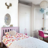 Girl's bedroom with purple bed and pink desk chair