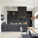 Open-plan kitchen with dark grey cabinetry, wood dining table and neutral pendant lighting