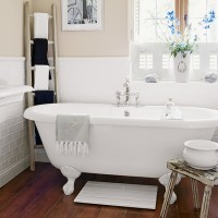 Cream country bathroom with dark wood floor