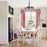 Rustic white country dining room with red stripes