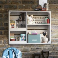 Garden shed wall with shelving unit