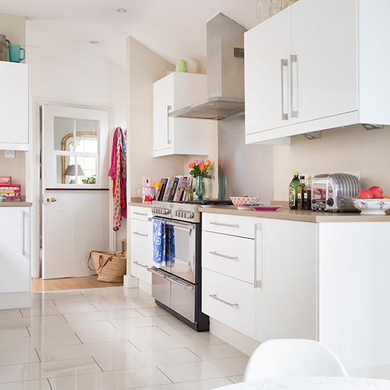 White Kitchen With Pale Ceramic Floor Tiles