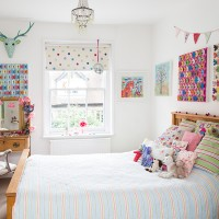 Child's white bedroom with multicoloured butterfly artwork