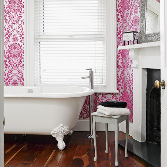 Modern bathroom with vivid pink wallpaper