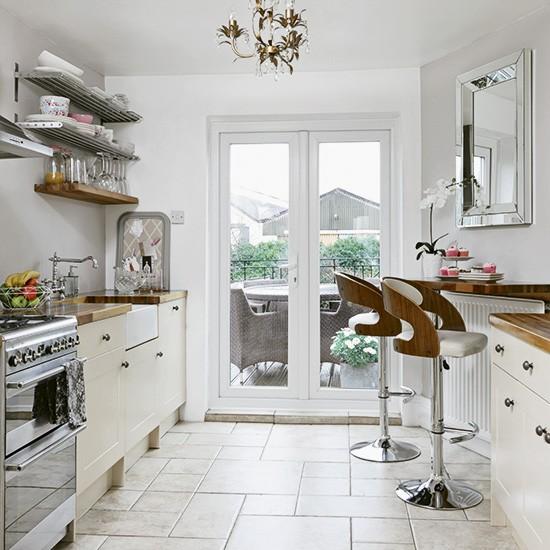 Modern cream kitchen with retro bar stools for Retro kitchen ideas uk