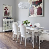 Grey dining room with modern art and chandelier