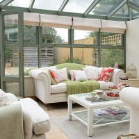Green conservatory with cream sofas
