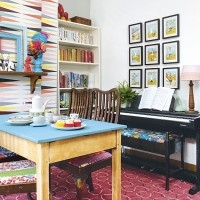 Retro dining room with picture wall and piano