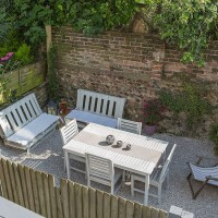Relaxed garden with outdoor dining and seating area