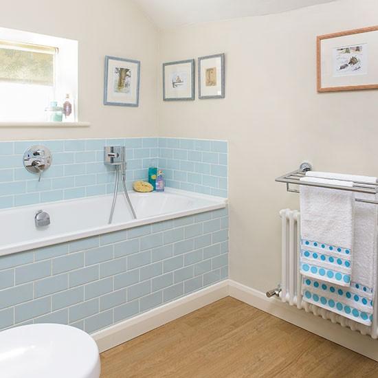 Bathroom with blue tiles and vinyl flooring decorating for Blue vinyl flooring bathroom