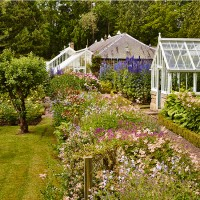 Traditional garden with glass greenhouses