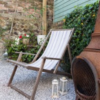 Country courtyard garden with deckchair
