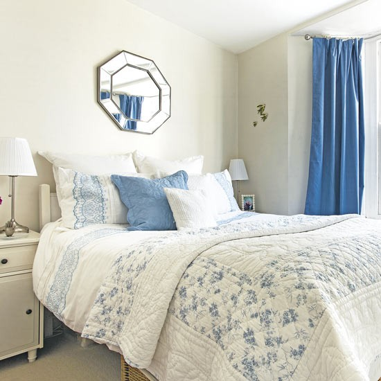 Traditional neutral bedroom with blue soft furnishings