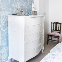 Traditional bedroom with painted chest of drawers