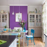 Dining room with purple feature wall and reclaimed furniture