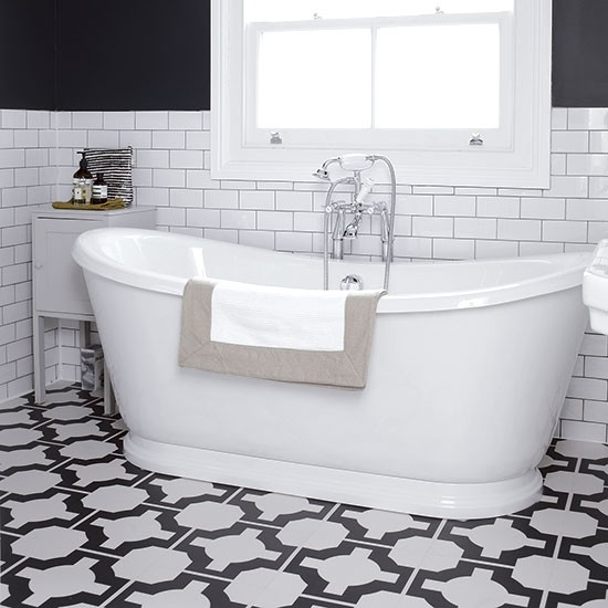 Monochrome bathroom with geometric floor decorating for Monochromatic bathroom designs