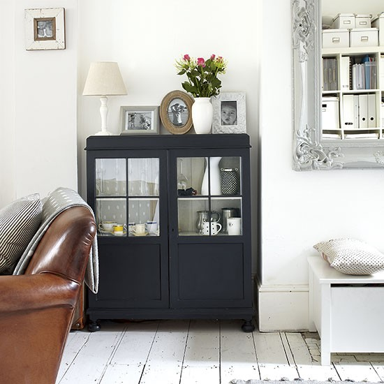 white living room with black cabinet decorating