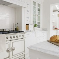 Bright white kitchen with cream range cooker