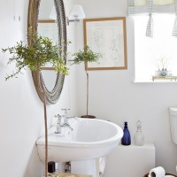 Plain white bathroom with potted plants