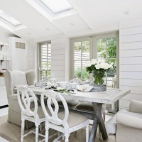 White and grey dining area with skylights