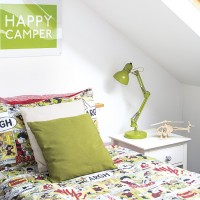 White modern children's room with green accents