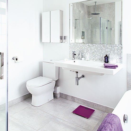 White Bathroom With Large Basin And Purple Accents