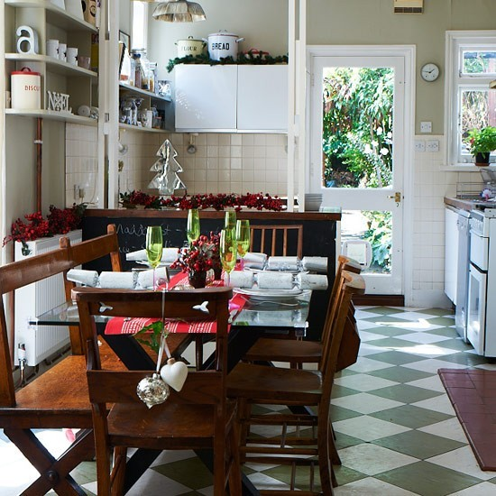 Festive kitchen diner with berry table decorations