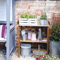Courtyard garden with with potting shelf