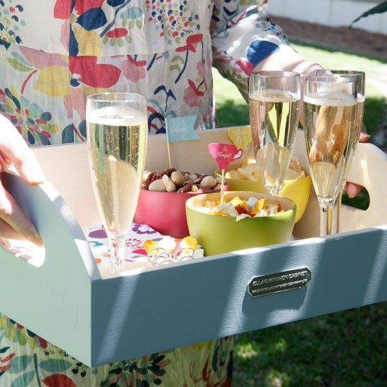 Garden party drinks tray with champagne and nibbles