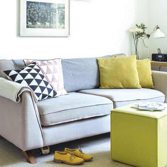 grey sofa with bright cushions