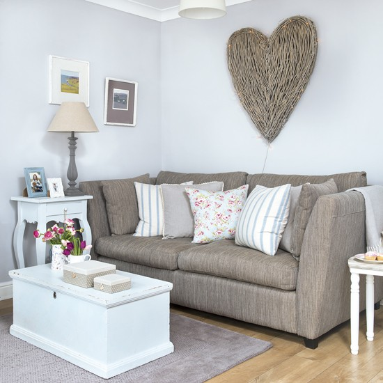 Pale Grey Living Room With Wicker Heart Wall Art