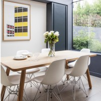 Grey and white dining room with Eames chairs