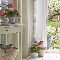 Pretty garden room with floral-edged curtains