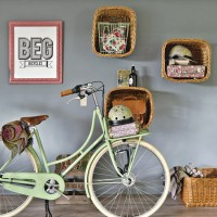 Grey hallway with wall-hung basket storage and bicycle