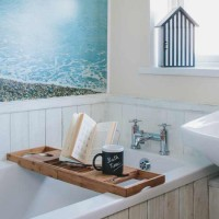 Tongue-and-groove bathroom with seascape mural