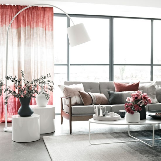 Grey living room with statement arc lamp and blush pink for Gray and pink living room ideas