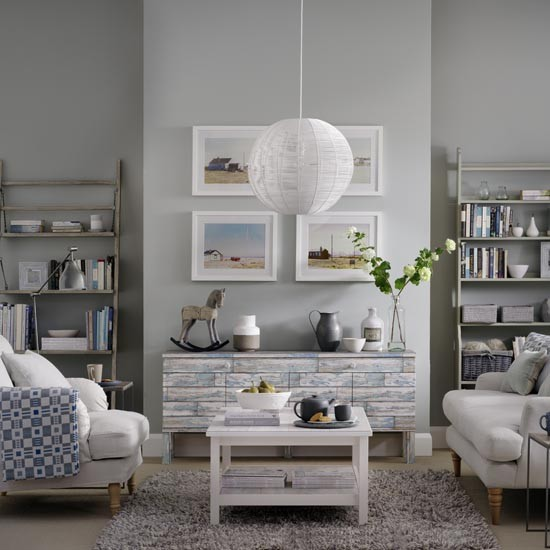 grey living room with weathered wood furniture and coastal