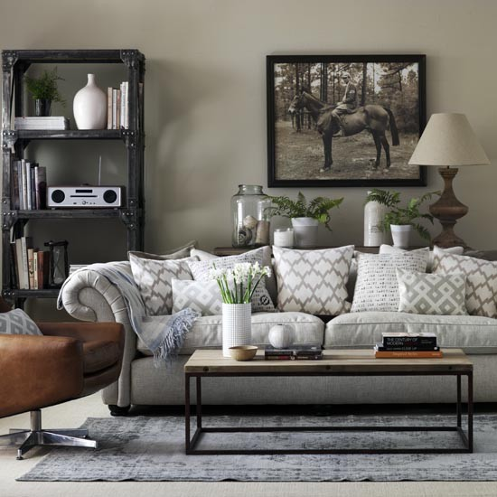 grey living room with chesterfield sofa and industrial style shelving