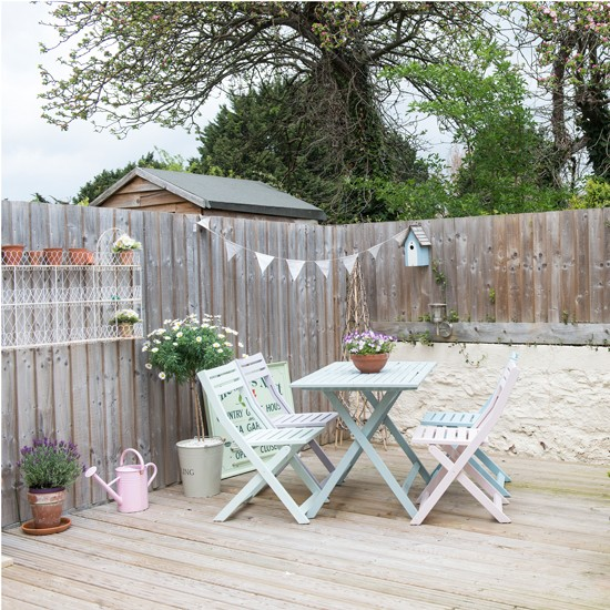 Outdoor Space With Decking And Pastel Painted Table And Chairs Housetohome
