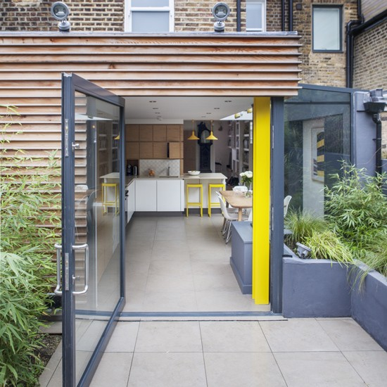 Modern kitchen extension with timber and metal finish for Extension to kitchen ideas