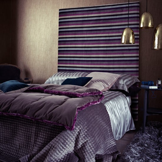 Purple Bedroom With Hits Of Gold And Striped Velvet